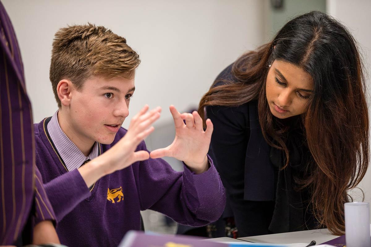 Student explaining and teacher listens