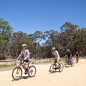 Students riding bikes at Clunes