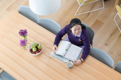 Student studying at the table in Learning in Residence