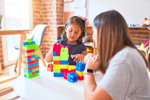 Mother and daughter playing with coloured blocks