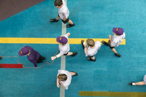 Top view of Wesley students walking in a cross shape